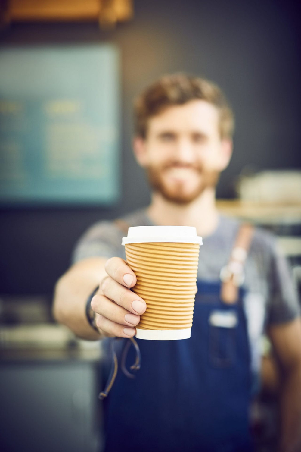 Coffee cup being held by barista